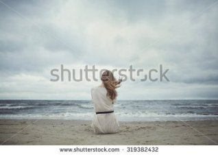 stock-photo-beautiful-alone-sensual-girl-on-the-beach-319382432