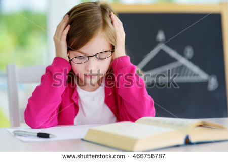 stock-photo-stressed-and-tired-schoolgirl-studying-with-a-pile-of-books-on-her-desk-child-feeling-unhappy-466756787