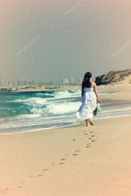 depositphotos_34612571-stock-photo-young-woman-in-white-dress