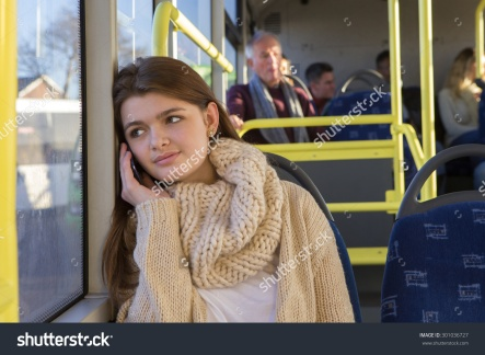 stock-photo-teenager-sitting-on-the-bus-she-is-looking-out-the-window-and-is-on-the-phone-to-someone-301036727