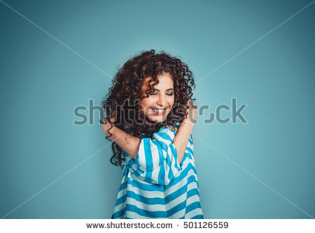 stock-photo-closeup-portrait-confident-smiling-woman-holding-hugging-herself-isolated-blue-wall-background-501126559