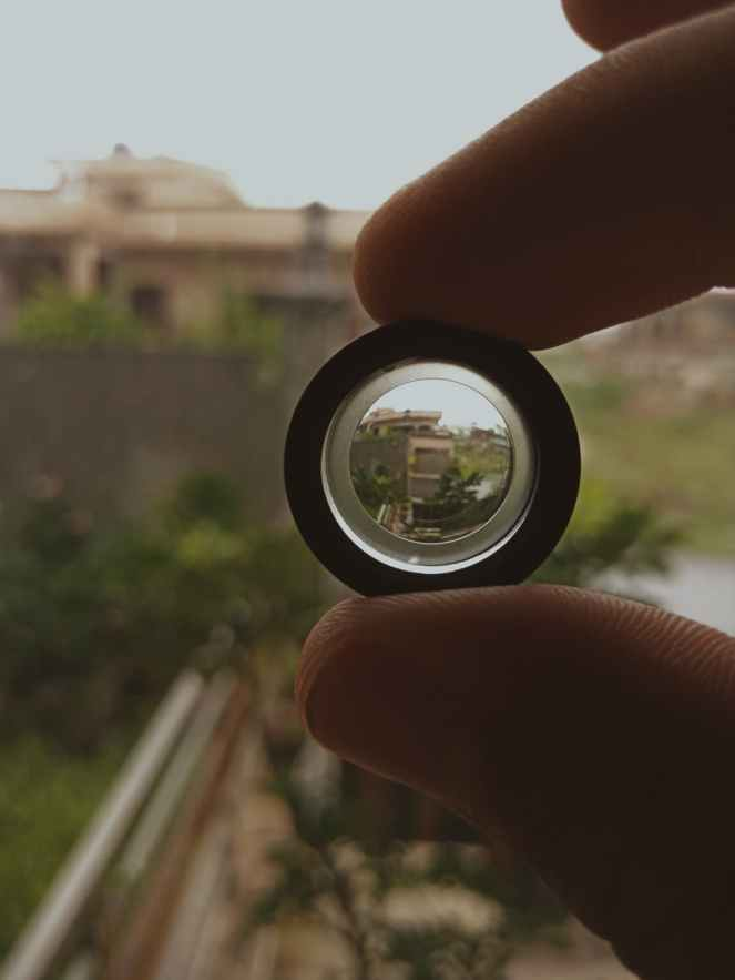 person holding black lens