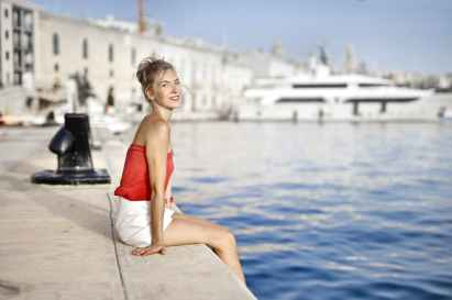 woman sitting near swimming pool